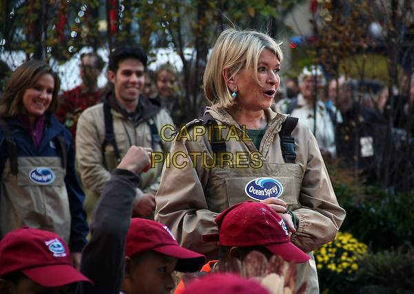 MARTHA STEWART.Ocean Spray's 6th Annual Big Apple Bog. Martha Stewart hosts 45 area children for a meal and taping of her show in a pool filled with 2,000 pounds of cranberries, New York, NY, USA..October 19th, 2010.half length beige jumpsuit mouth open funny .CAP/ADM/PZ.©Paul Zimmerman/AdMedia/Capital Pictures.