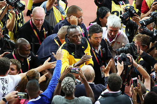 August 13th 2017, London Stadium, East London, England; IAAF World Championships, Day 10; Usain Bolt of Jamaica is mobbed by fans during a final lap of honour around the track