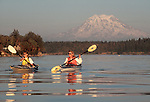 Sea kayakers, Mount Rainier, Puget Sound, Washington State, Pacific Northwest, Two women paddle off the Nisqually Reach,.
