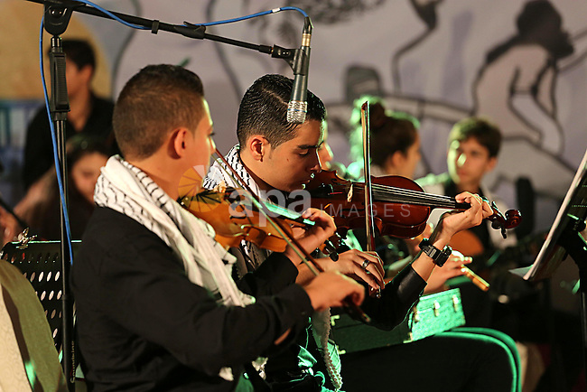 Palestinian youths play music during an event to show solidarity with the Palestinians in the West Bank and Jerusalem, in Gaza city on November 18, 2015. The surge in violence across Israel, Jerusalem and the Israeli-occupied West Bank has been fuelled in part by a dispute over access to a site in Jerusalem holy both Muslims. Photo by Mohammed Asad