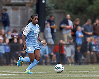 University of North Carolina midfielder Crystal Dunn (19) at midfield.   University of North Carolina (blue) defeated Boston College (white), 1-0, at Newton Campus Field, on October 13, 2013.