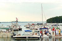 "Event photography of the Charlotte Symphony performing in a free outdoor concert June 17, 2012 at Duke Energy's McGuire Nuclear Station EnergyExplorium in Cornelius, NC. The symphony orchestra performed a ""musical travels"" program. Boaters on Lake Norman enjoy the music while floating on the water nearby."