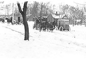 Three horse-drawn delivery wagons in snowy Durango neighborhood.  5th Ave &amp; 7th Street (Rex Mollette's house)<br /> Durango, CO  Taken by Mollette, Erskine (Rex) - ca. 1910