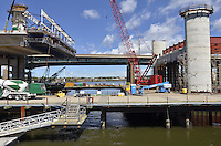 Pearl Harbor Memorial Bridge, New Haven Harbor Crossing Corridor, Interstate 95 in CT. Construction of Connecticut Department of Transportation Contract B as seen on September 9, 2011. New Northbound Span, Progress of the Replacement Bridge. When complete this will be the first Extradosed Bridge in the United States. This view includes Traveling Formwork, platforms, and inner harbor at the eastern end of Bridge.