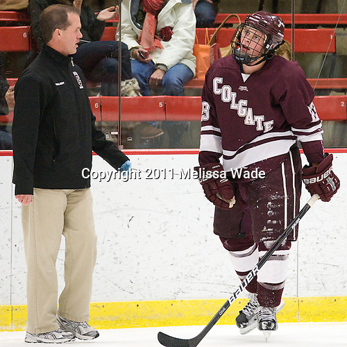 Steve Chouinard (Colgate - Trainer), Chris Wagner (Colgate - 23) - The Harvard University Crimson defeated the visiting Colgate University Raiders 4-2 on Saturday, November 12, 2011, at Bright Hockey Center in Cambridge, Massachusetts.
