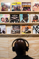 Darryll Vanne listens to Thelonious Monks albums at a listening station during the Monk @ 100 festival at the Durham Fruit and Produce Company in Durham, NC Wednesday, October 25, 2017. (Justin Cook for The New York Times)