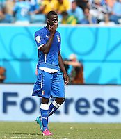 Mario Balotelli of Italy shows a look of dejection