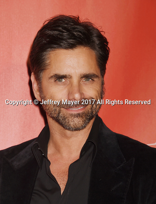 LOS ANGELES, CA - FEBRUARY 10: Actor John Stamos attends MusiCares Person of the Year honoring Tom Petty at the Los Angeles Convention Center on February 10, 2017 in Los Angeles, California.