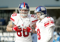 27 Nov 2005:   New York Giants quarterback Tim Hasselback and tight end Jeremy Shockey warmed up before the start of the game against the Seattle Seahawks at Qwest Field in Seattle, Washington.
