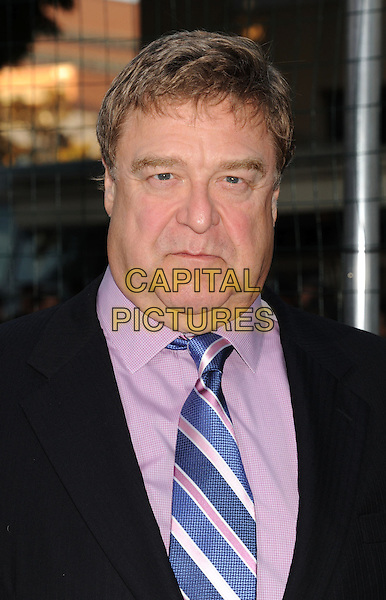 "John Goodman.""Trouble With The Curve"" Los Angeles Premiere held at the Regency Village Theatre, Westwood, California, USA..September 19th, 2012.headshot portrait suit black blue tie pink shirt   .CAP/ROT/TM.©Tony Michaels/Roth Stock/Capital Pictures"