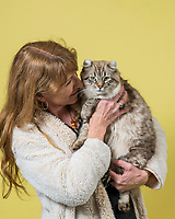 Bobbi Temple of Sussex, Wis. holds her Highlander named Leroy Sloane at the 44th East of Eden Cat Fancier's in Monterey, Calif. on Feb. 22, 2020.
