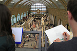 Two art students drawing the interior of the Musee D'Orsay, Paris, France. .  John offers private photo tours in Denver, Boulder and throughout Colorado, USA.  Year-round. .  John offers private photo tours in Denver, Boulder and throughout Colorado. Year-round.