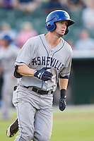 David Dahl (21) of the Asheville Tourists hustles down the first base line against the Kannapolis Intimidators at CMC-NorthEast Stadium on July 12, 2014 in Kannapolis, North Carolina.  The Tourists defeated the Intimidators 7-5 in 15 innings.  (Brian Westerholt/Four Seam Images)