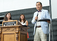 From left, Larissa Saco '14 and Megan Sumida '14 listen as Adjunct assistant history professor Paul Nam talks after receiving the Donald Loftsgordon Memorial Award for Outstanding Teaching during Senior Brunch and Class Day, May 16, 2014 in Rush Gym. (Photo by Marc Campos, Occidental College Photographer)