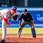 16 July 2017: Umpire Marcelo Alfonzo works the infield during a minor league baseball game between the Auburn Doubledays and the Vermont Lake Monsters at Centennial Field in Burlington, Vermont. The Monsters defeated the Doubledays 6-3 in NY Penn League action. Mandatory Credit: Ed Wolfstein Photo *** RAW (NEF) Image File Available ***