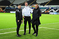 (L-R) Sports scientist, Jordan Smith and Dr. Jez McCluskey, Club Doctor of Swansea City share a joke with Garry Monk Manager of Birmingham City prior to the Sky Bet Championship match between Swansea City and Birmingham City at the Liberty Stadium in Swansea, Wales, UK. Tuesday 29 January 2019