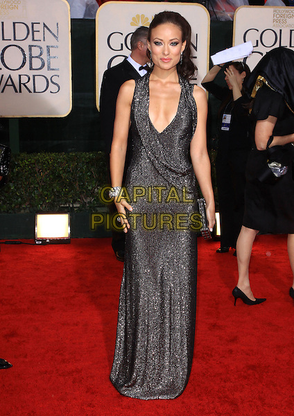 OLIVIA WILDE .67th Golden Globe Awards held Beverly Hilton, Beverly Hills, California.17th January 2010..arrivals globes full length silver black sparkly chainmail dress sleeveless low cut brown bracelet clutch bag long maxi .CAP/ADM/KB.©Kevan Brooks/Admedia/Capital Pictures