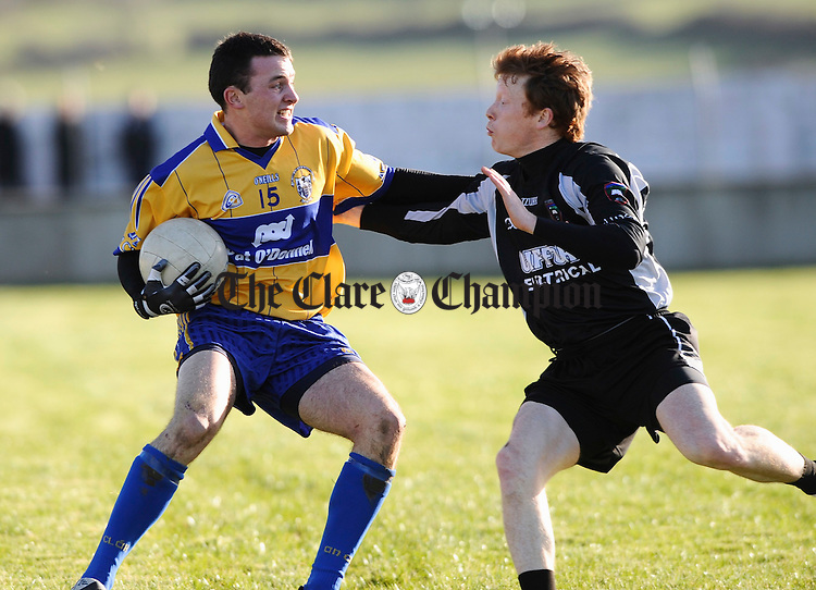 Clare's David Tubridy is tackled by Sligo's Charles Harrison during their National League game at Cooraclare. Photograph by John Kelly.