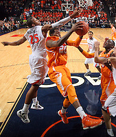 Tennessee forward Kenny Hall (20) grabs a rebound next to Virginia forward Akil Mitchell (25) during the game Wednesday in Charlottesville, VA. Virginia defeated Tennessee 46-38.