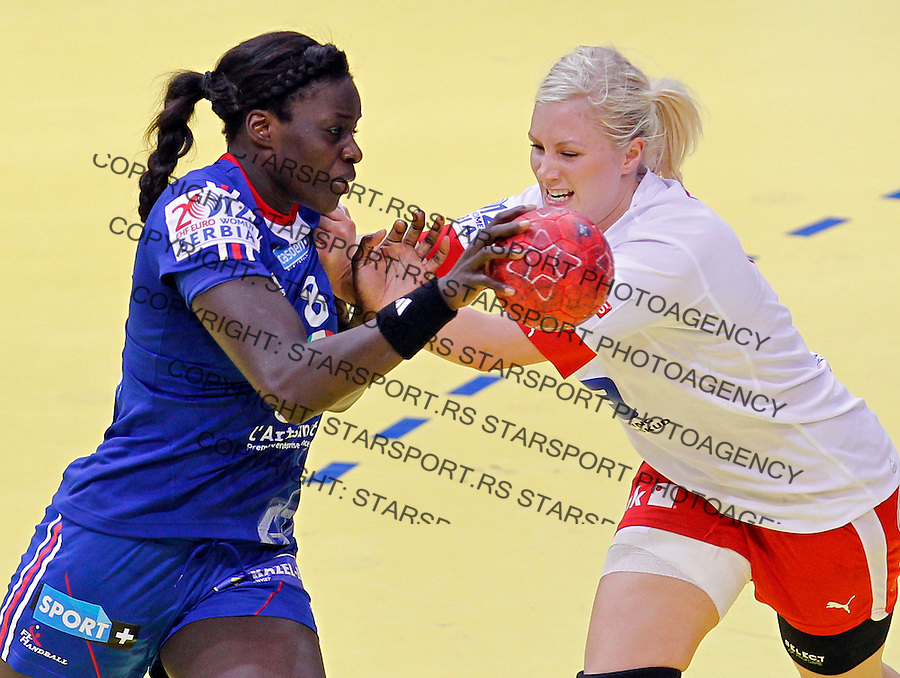 NIS, SERBIA 6/12/2012/ Claudine Mendy of France (L) fights for the ball with Denmark`s Lotte Grigel (R) during Women`s European Handball Championship EHF EURO 2012 match between Denmark and France in Cair arena in city of Nis in southern Serbia on  December 6, 2012 Credit: PEDJA MILOSAVLJEVIC/SIPA/