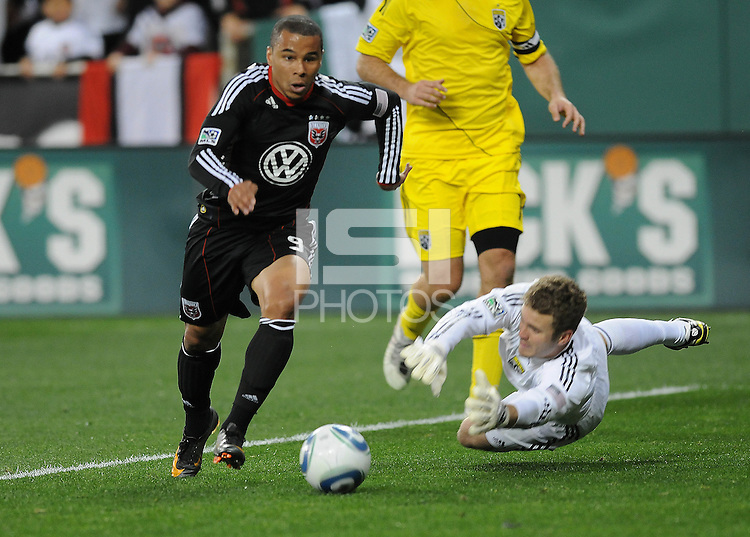 DC United forward Charlie Davies (9) goes against  Columbus Crew goalkeeper William Hesmer (1) .  DC United defeated The Columbus Crew 3-1 at the home season opener, at RFK Stadium, Saturday March 19, 2011.