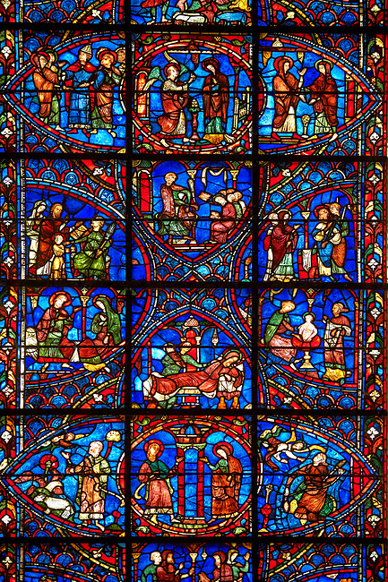 Medieval Windows of the Gothic Cathedral of Chartres, France, dedicated to the life of the Virgin Mary.   The bottom centre oval panel shows Anna and Joachim meet at the Golden Gate,  left Annunciation to Joachim , right Annunciation to Anna , above the nativity. Top centre oval shows the annunciation of the Virgin, left the marriage of Joseph and Mary, right the visitation below the virgin Matuy at school. Left side panels - bottom Anna and Joachim awaiting the birth of Mary above Her parents presenting the Virgin Mary to a schoolmaster . Right side panel, bottom - the first bath of Mary above Mary betrothal to Joseph after the test of the rods. A UNESCO World Heritage Site.