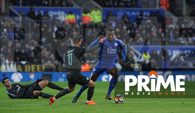 Wes Morgan of Leicester City takes on Chelsea players during the FA Cup QF match between Leicester City and Chelsea at the King Power Stadium, Leicester, England on 18 March 2018. Photo by Stephen Buckley / PRiME Media Images.