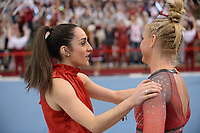 Arkansas coach Jordyn Wieber speaks Friday, Feb. 7, 2020, with Sarah Shaffer during the Razorbacks' meet with Georgia in Barnhill Arena in Fayetteville. Visit  nwaonline.com/gymbacks/ for a gallery from the meet.<br /> (NWA Democrat-Gazette/Andy Shupe)