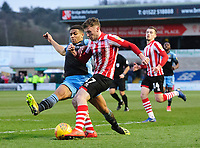 Lincoln City's Shay McCartan crosses the ball despite the attentions of Stevenage's Luther Wildin<br /> <br /> Photographer Chris Vaughan/CameraSport<br /> <br /> The EFL Sky Bet League Two - Lincoln City v Stevenage - Saturday 16th February 2019 - Sincil Bank - Lincoln<br /> <br /> World Copyright © 2019 CameraSport. All rights reserved. 43 Linden Ave. Countesthorpe. Leicester. England. LE8 5PG - Tel: +44 (0) 116 277 4147 - admin@camerasport.com - www.camerasport.com