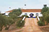 The old farm house in traditional Portuguese style. Dirt road leading up to the winery. Herdade da Malhadinha Nova, Alentejo, Portugal