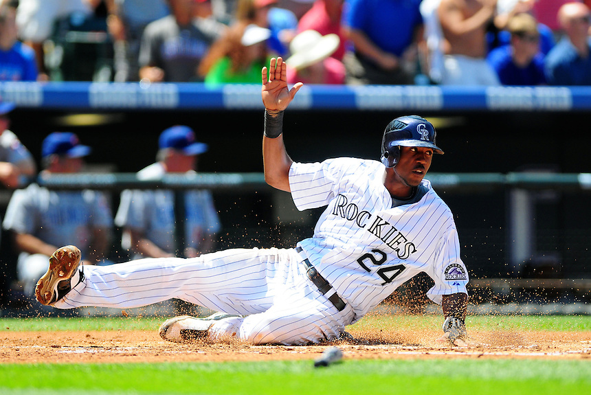 August 9, 2009: Rockies outfielder Dexter Fowler slides past home as he scores a run during a regular season game between the Chicago Cubs and the Colorado Rockies at Coors Field in Denver, Colorado. The Rockies beat the Cubs 11-5. *****For editorial use only*****