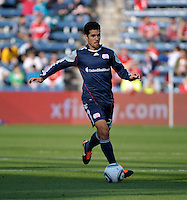 New England midfielder Benny Feilhaber (22) dribbles the ball.  The Chicago Fire defeated the New England Revolution 3-2 at Toyota Park in Bridgeview, IL on Sept. 25, 2011.