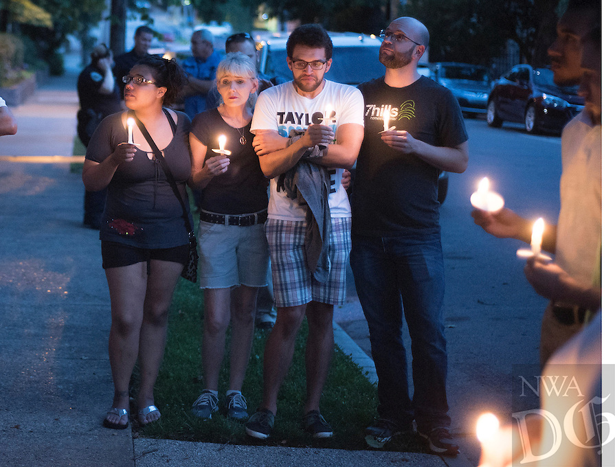 NWA Democrat-Gazette/J.T. WAMPLER Participants gather Sunday June 12, 2016 at St. Paul's Episcopal Church in Fayetteville during a vigil for the victims of the Orlando shooting. Around 500 people attended the vigil and marched down Dickson St.