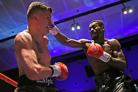 Kingsley Egbunike (black shorts) defeats Kristaps Zulgis during a Boxing Show at Cliffs Pavilion on 17th February 2020