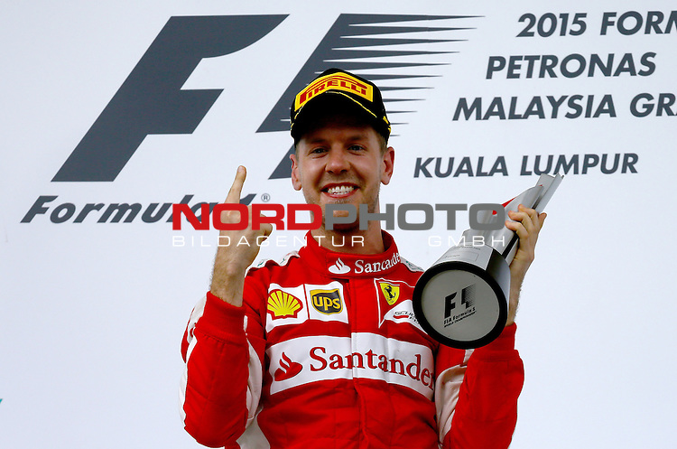 28.03.2011, Sepang-International-Circuit, Malaysia, MAL das rennen , Gro&szlig;er Preis von Malaysia / Kuala Lumpur, Training im Bild Sebastian Vettel (GER), Scuderia Ferrari<br /> for the complete Middle East, Austria &amp; Germany Media usage only!<br />  Foto &copy; nph / Mathis