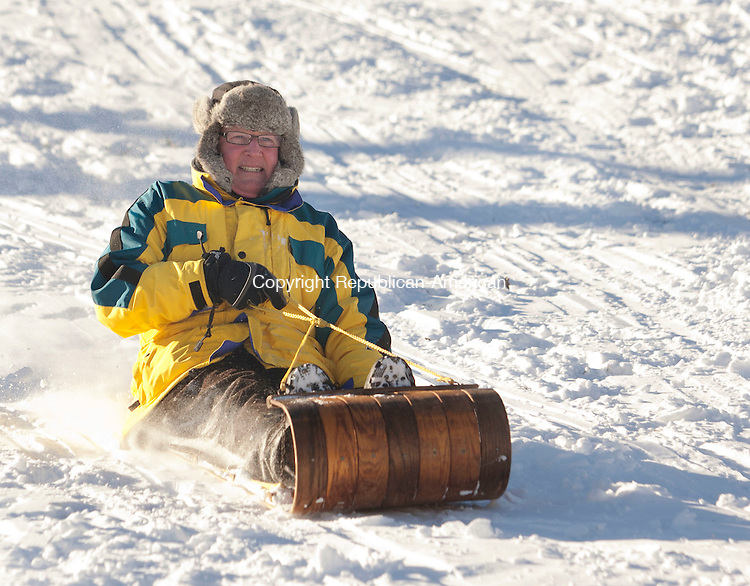 SOUTHBURY, CT-03 January 2014-010314BF05- Jim Geraghty from Southbury rides an Adirondack toboggan sled while sledding on a hill on Poverty Road at the golf course at the Heritage Village Country Club in Southbury Friday afternoon. Geraghty was sledding with his grandson Brian Kelly, 5, from New York City.   Bob Falcetti Republican-American<br /> <br /> (cq- Jim Geraghty)