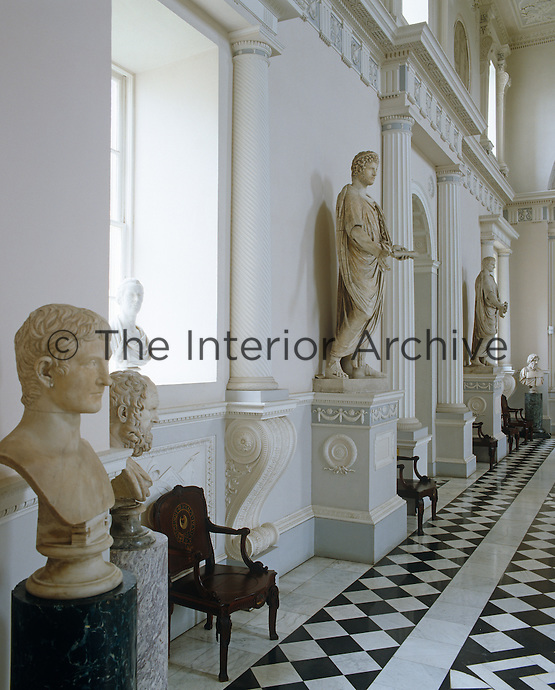 The Great Hall at Syon House was designed by Robert Adam and is furnished with statues like a Roman atrium