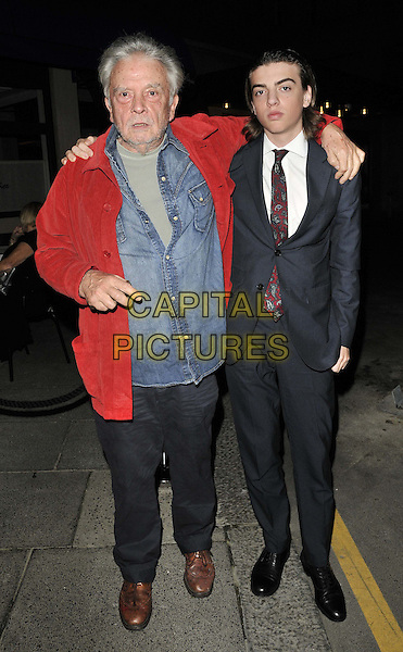 David Bailey & his son Sascha Bailey .Le Caprice restaurant's 30th anniversary party, Le Caprice, Arlington St., London, England..October 4th, 2011.full length blue shirt black suit white shirt red jacket arm over shoulder father dad family trousers .CAP/CAN.©Can Nguyen/Capital Pictures.