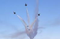 The Blue Angels diamond executes a Barrel Roll Break maneuver during the 2017San Francisco Fleet Week airshow.
