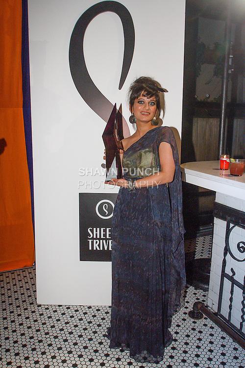 Fashion designer Sheena Trivedi holding bottle from drink sponsor Fou-Dre Vodka, during her Sheena Trivedi Spring Summer 2014 collection fashion show, at Hotel Chantelle on October 21, 2013.