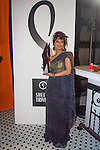 Fashion designer Sheena Trivedi holding bottle from drink sponsor Fou-Dre Vodka, during her Sheena Trivedi Spring Summer 2014 collection fashion show, at Hotel Chantelle on October 21, 2013.