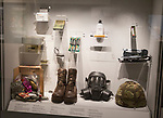 Display cabinet of army equipment including respirator, boots, helmet, REME museum, MOD Lyneham, Wiltshire, England, UK
