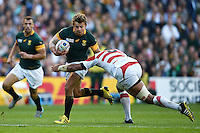 Patrick Lambie of South Africa looks to get past Michael Leitch of Japan. Rugby World Cup Pool B match between South Africa and Japan on September 19, 2015 at the Brighton Community Stadium in Brighton, England. Photo by: Patrick Khachfe / Onside Images