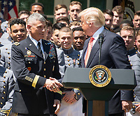 Lieutenant General Robert Caslen, United States Army, Superintendent of the US Military Academy, shakes hands with US President Donald J. Trump as the President presents the Commander-in-Chief's Trophy to the U.S. Military Academy football team in the Rose Garden of the White House in Washington, DC on Tuesday, May 1, 2018.  The Commander-in-Chief's trophy is presented to the winner of the annual Army-Navy football game which was played at Lincoln Financial Field in Philadelphia, Pennsylvania on December 9, 2017.  The Army Black Knights beat the Navy Midshipmen 14 - 13.<br /> Credit: Ron Sachs / CNP /MediaPunch