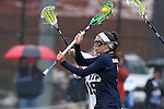 01 March 2015: Notre Dame's Cortney Fortunato takes a shot in front of Duke's Claire Scarrone (19). The Duke University Blue Devils hosted the University of Notre Dame Fighting Irish on the West Turf Field at the Duke Athletic Field Complex in Durham, North Carolina in a 2015 NCAA Division I Women's Lacrosse match. Duke won the game 17-3.
