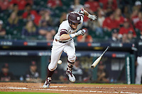 Jake Mangum (15) of the Mississippi State Bulldogs starts down the first base line after laying down a bunt during the game against the Houston Cougars in game six of the 2018 Shriners Hospitals for Children College Classic at Minute Maid Park on March 3, 2018 in Houston, Texas. The Bulldogs defeated the Cougars 3-2 in 12 innings. (Brian Westerholt/Four Seam Images)