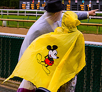 LOUISVILLE,KNY - MAY 04: fans trying to stay dry during Thurby at Churchill Downs, Louisville, Kentucky, May 4, 2017. (Photo by Sue Kawczynski/Eclipse Sportswire/Getty Images)