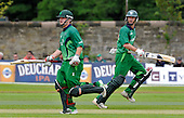 Cricket - ODI Summer Tri-Series - Scotland V Ireland at Grange CC - Edinburgh - Ireland batsman Paul Stirling (left) on his way to making 133. Non-striking batsman Alex Cusack went on to make 71 - Picture by Donald MacLeod - 12.07.11 - 07702 319 738 - www.donald-macleod.com