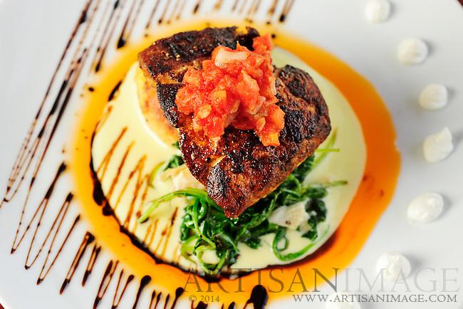 Blackened Grouper over a spaghetti squash cake, broccoli sautéed with lump crab meat, avocado salsa, tomato relish, sour cream and cream corn sauce. (Photo/Artisan Image, Inc.)