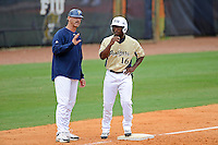 """4 March 2012:  FIU Head Coach Henry """"Turtle"""" Thomas speaks with outfielder Roche Woodard (16) as the FIU Golden Panthers defeated the Brown University Bears, 8-3, at University Park Stadium in Miami, Florida."""